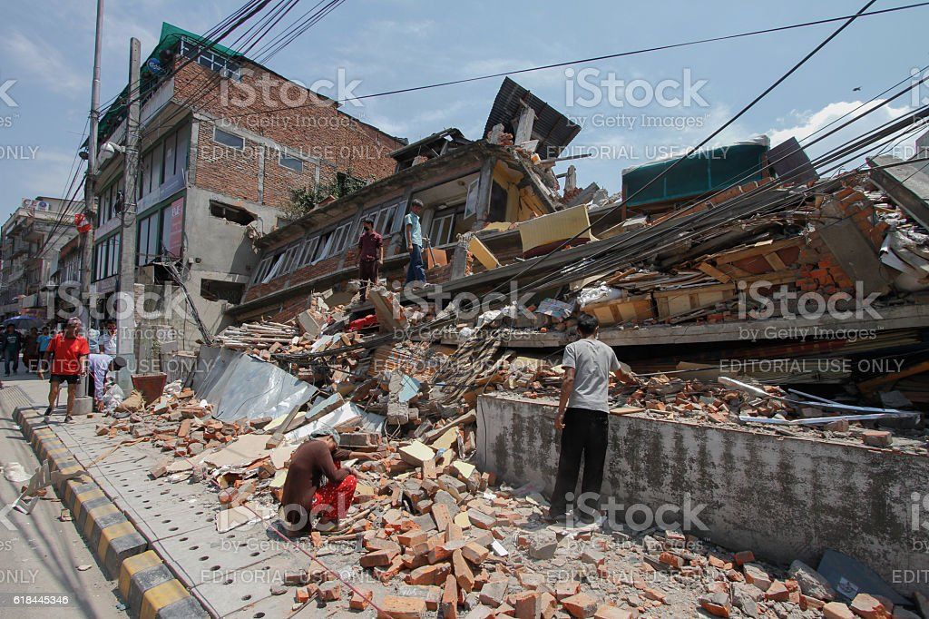 Clearing the rubble after the earthquake, Kathmandu stock photo