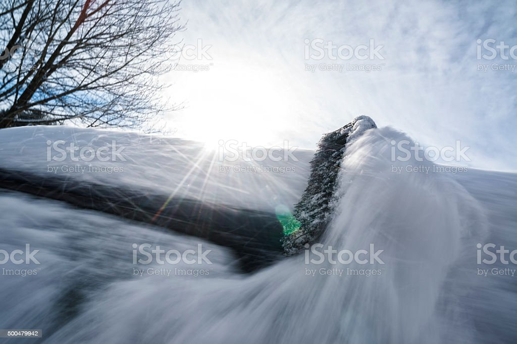 Clearing the snow from a car, Motion Blur stock photo