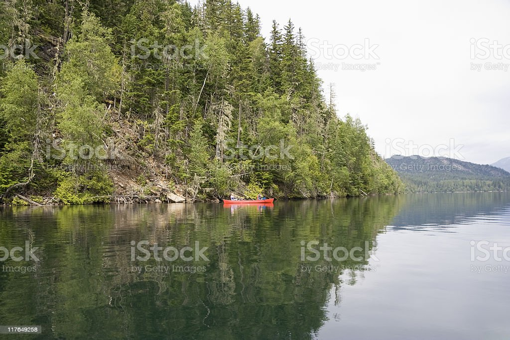 Clearwater lake with canoe royalty-free stock photo