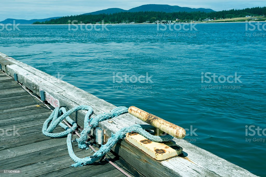 Cleat and rope for crab boat on dock in Washington stock photo