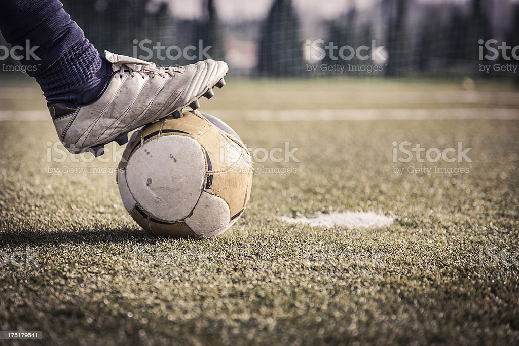 Cleat on a soccer ball ready to kick it in the net stock photo