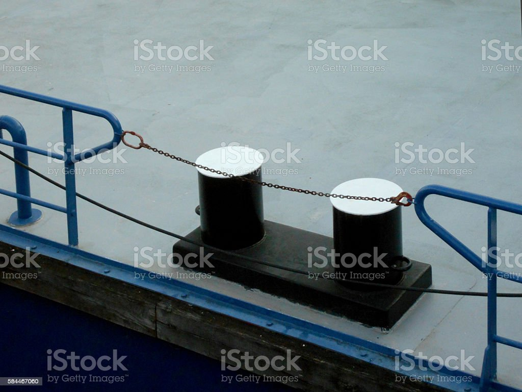 cleats on the floating platform in the marina stock photo