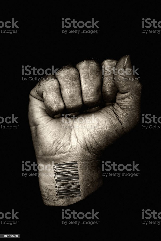 Clenched Fist with Barcode on Wrist, Toned stock photo