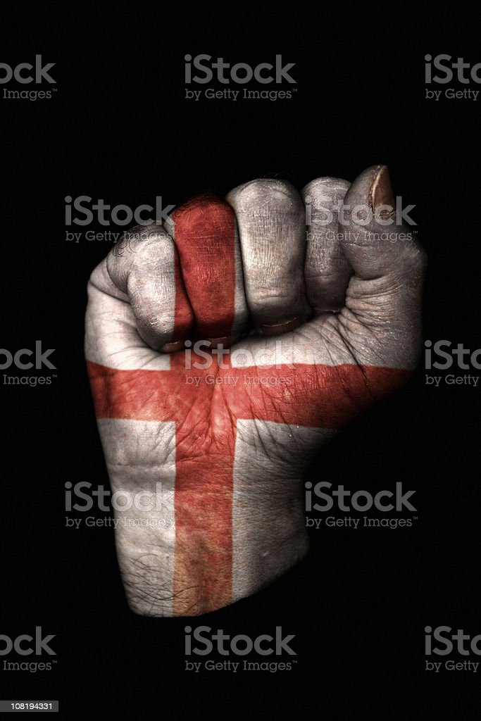 Clenched Fist with English Flag Painted, Isolated on Black royalty-free stock photo