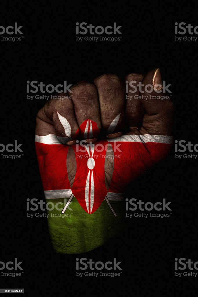 Clenched Fist with Kenyan Flag Painted, Isolated on Black royalty-free stock photo