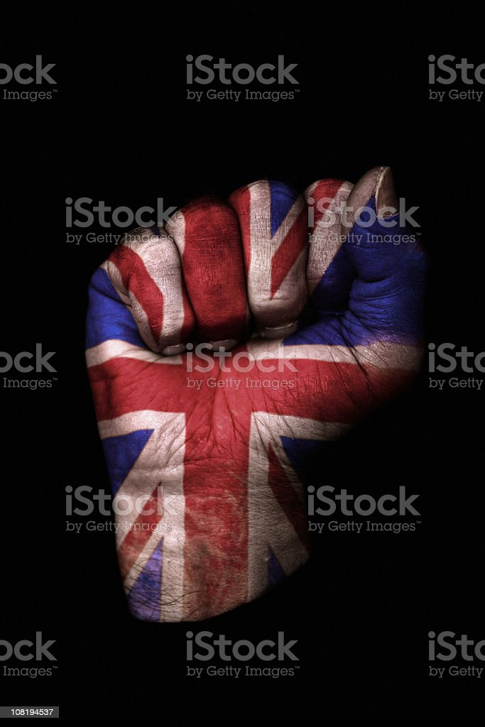 Clenched Fist with Union Jack Flag Painted, Isolated on Black stock photo