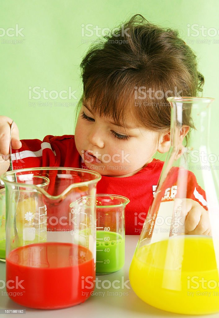 clever baby girl and chemical tubes stock photo