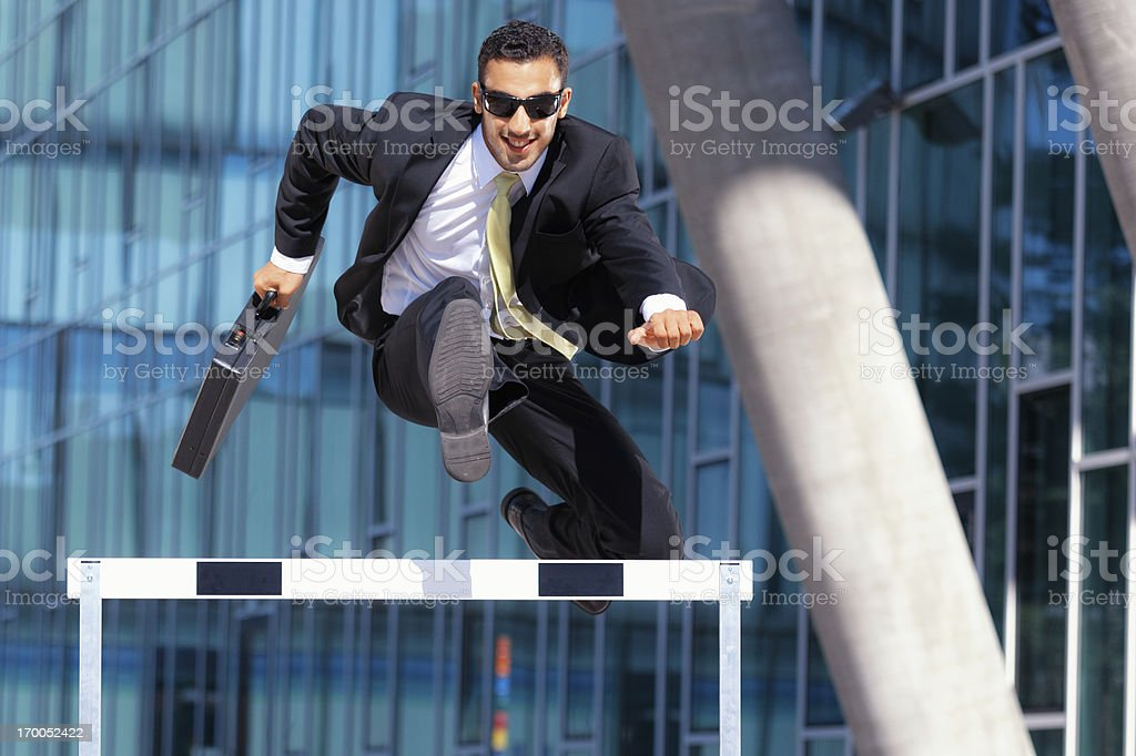 clever dynamic business hurdler stock photo