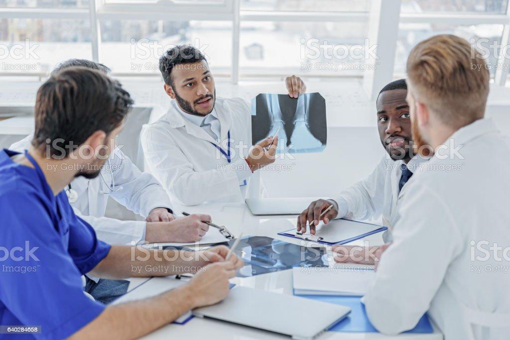 Clever medical team diagnosing human illness stock photo