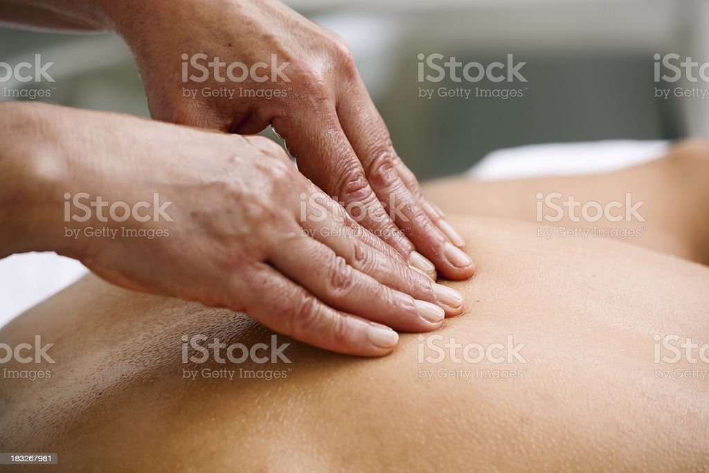 Client Getting a Deep Tissue Massage royalty-free stock photo