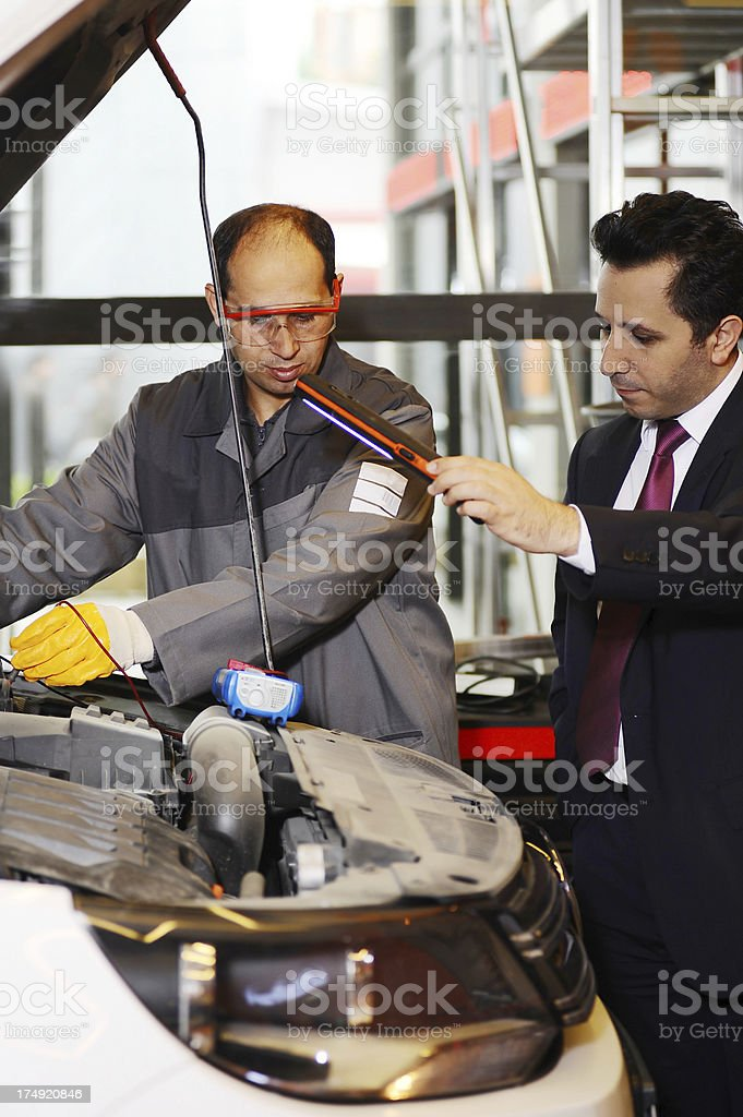 Client helps mechanic royalty-free stock photo