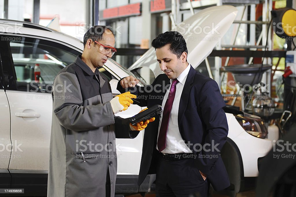 Client pointing car problem royalty-free stock photo