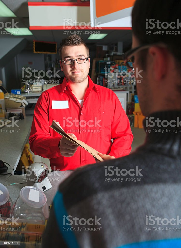 Client Receive from Clerk Hardware Store royalty-free stock photo