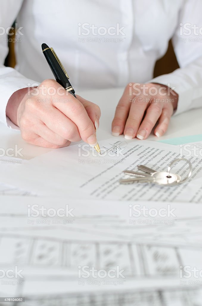 Client signing a real estate contract stock photo