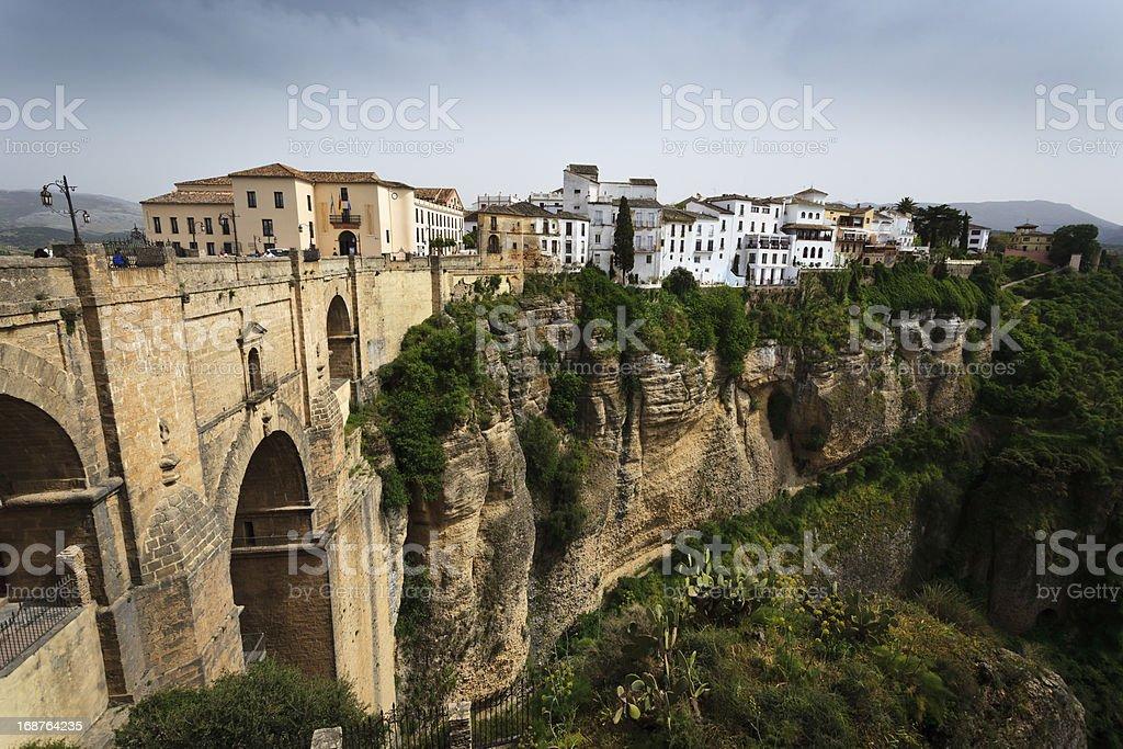 Cliff, 18th century bridge,  city buildings, gorge at Ronda, Spain royalty-free stock photo
