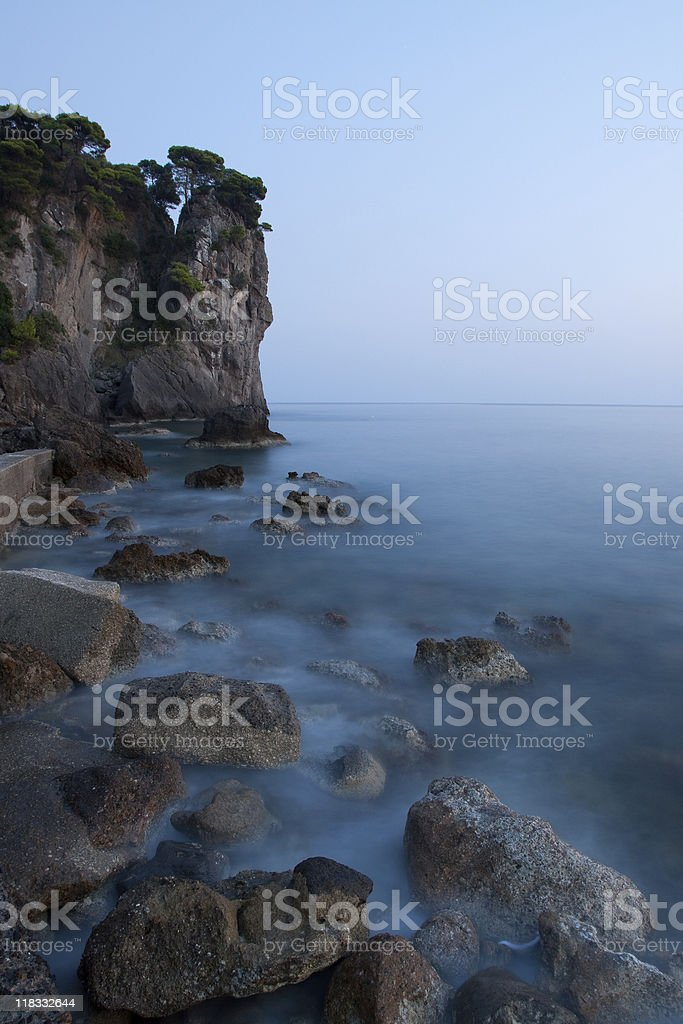 Cliff and beach at sunset stock photo