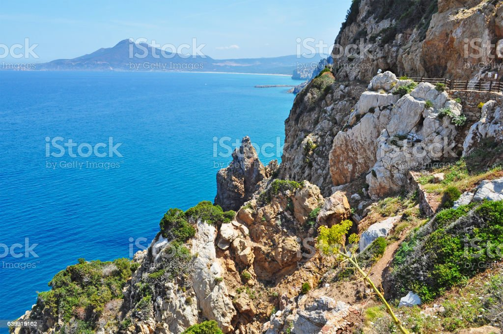 cliff and blue sea stock photo
