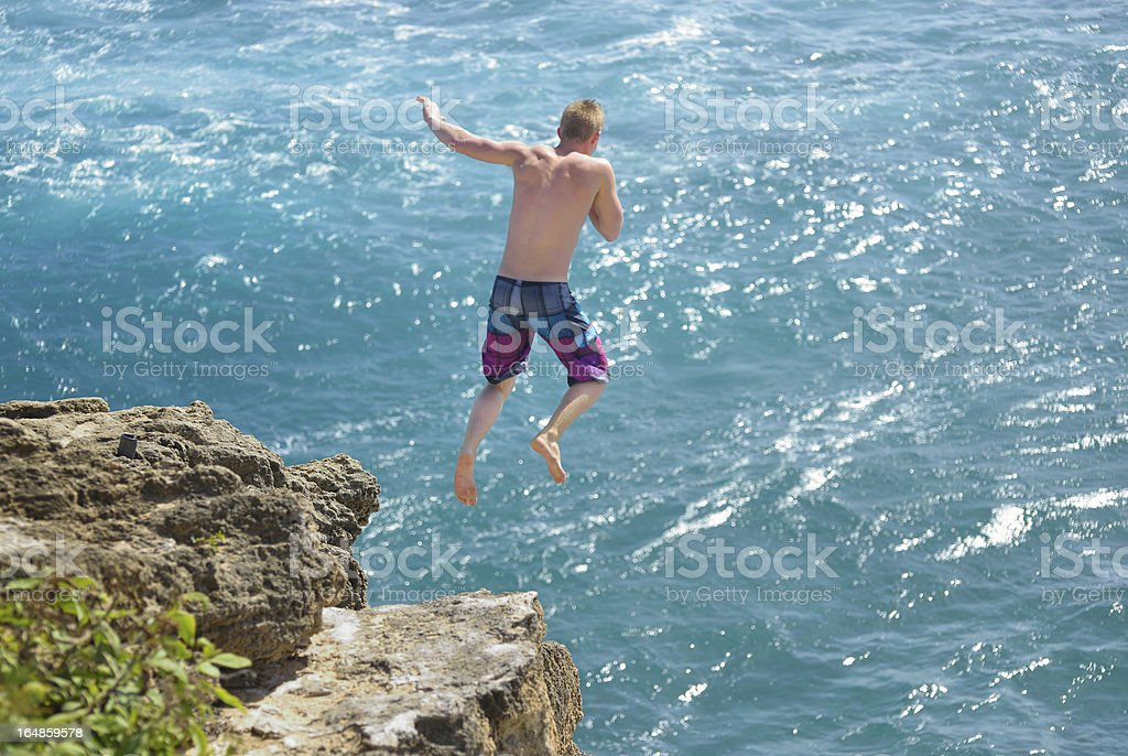 Cliff Diving in Kauai, Hawaii USA royalty-free stock photo