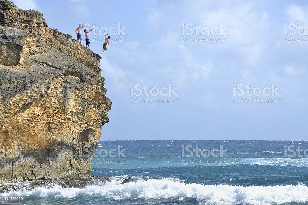 Cliff Diving in Kauai, Hawaii USA royalty-free stock photo