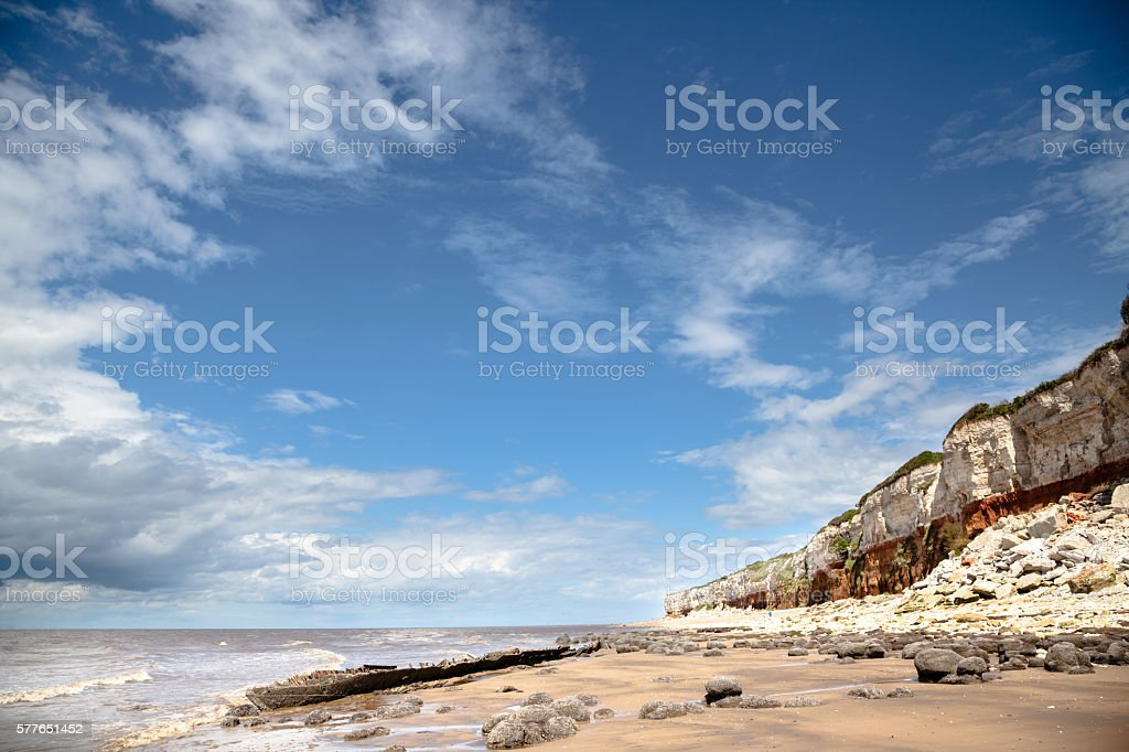 cliff erosion and shipwreck at Hunstanton Eastern England in summer stock photo