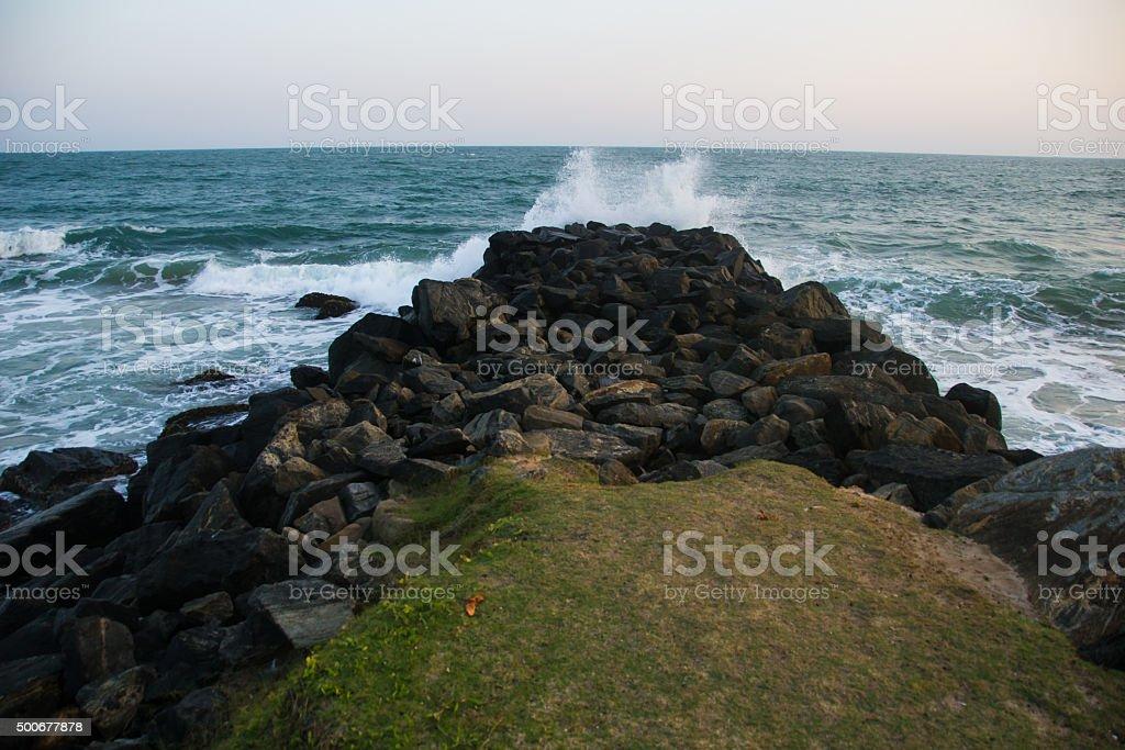 Cliff in ocean stock photo