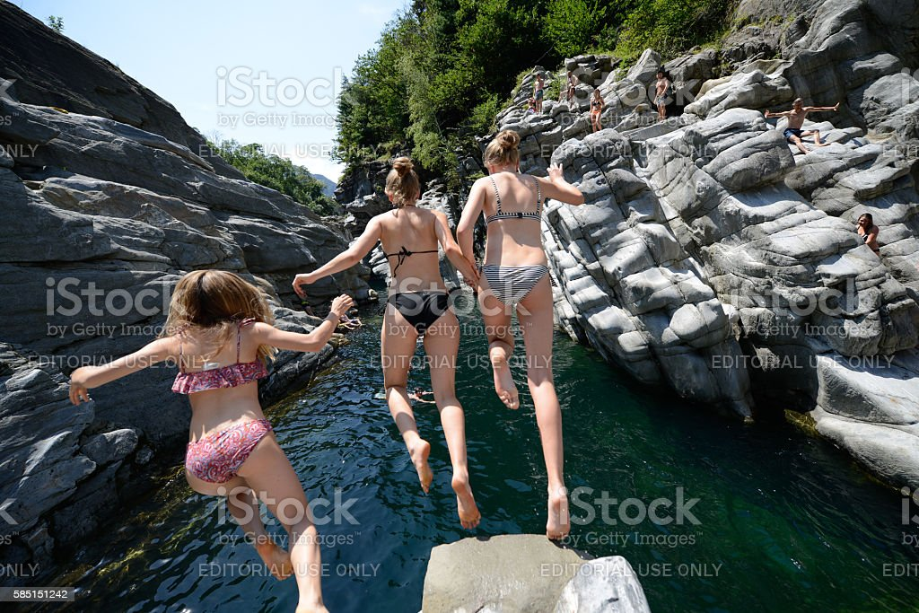 Cliff jumping in Ticino stock photo