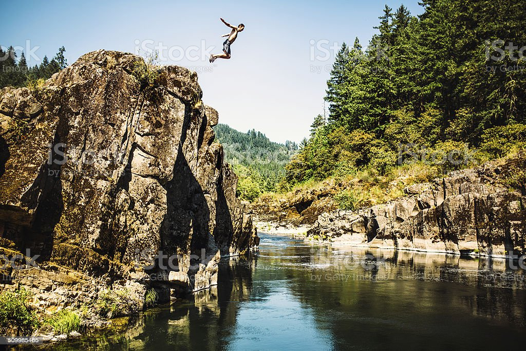 Cliff Jumping Man stock photo