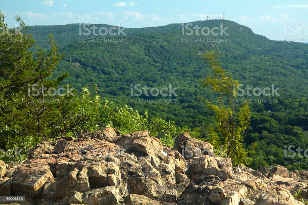 Cliff on Ragged Mountain, with view of Hanging Hills, Connecticut. stock photo