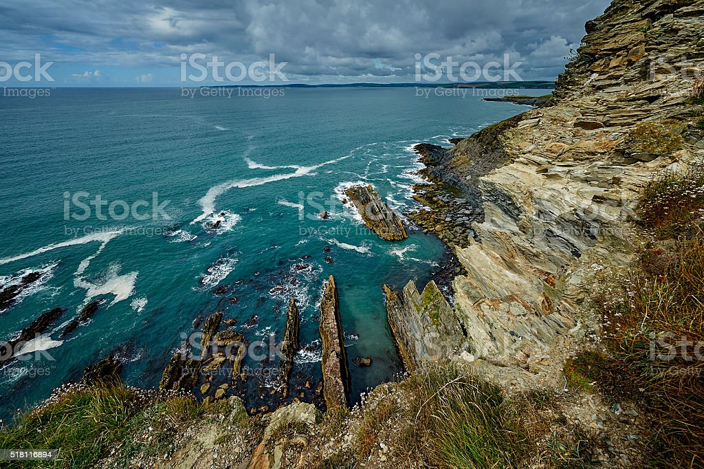 Cliff over Atlantic Ocean at Irish coastline, nature stock photo