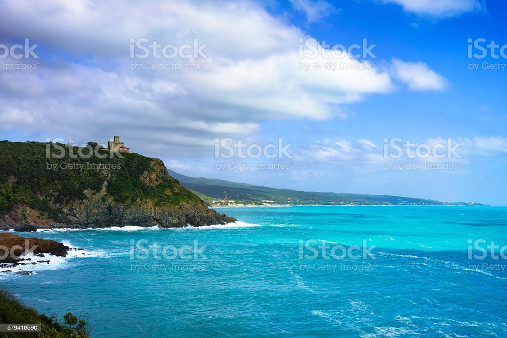 Cliff rock and building  the sea on sunset. Quercianella, Tusc stock photo