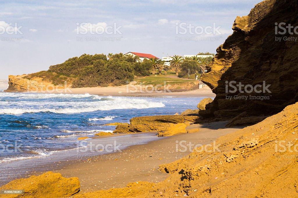 Cliff stone beach village sea waves, beautiful nature landscape. stock photo