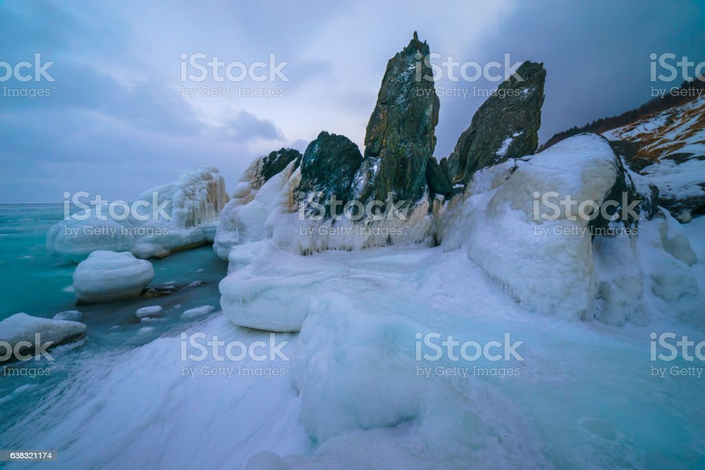 Cliff through a sad sunset in the winter, Sakhalin island stock photo