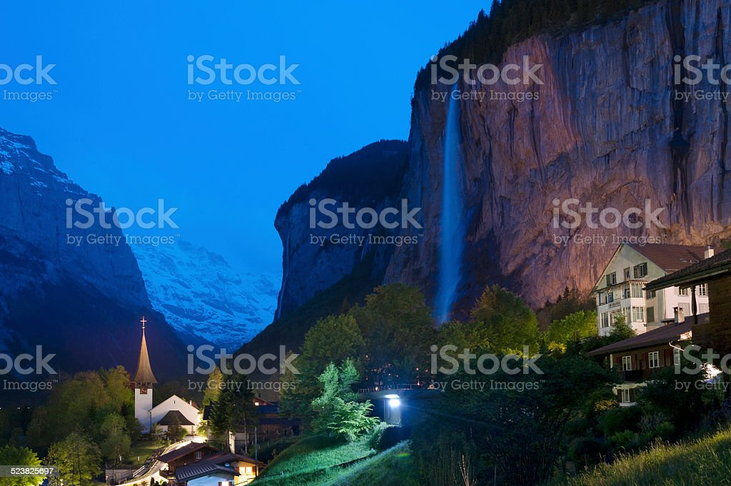 Cliff, Waterfall and village stock photo