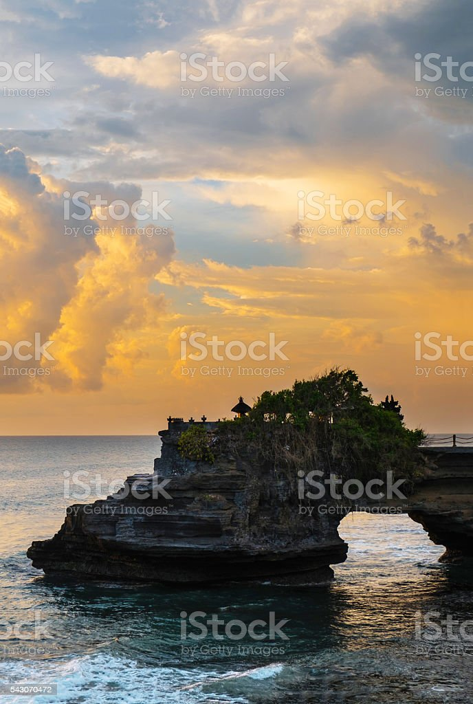 Cliff with natural arch in sunset at Bali island stock photo