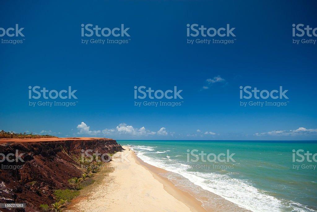Cliffs and beach at Praia das Minas stock photo