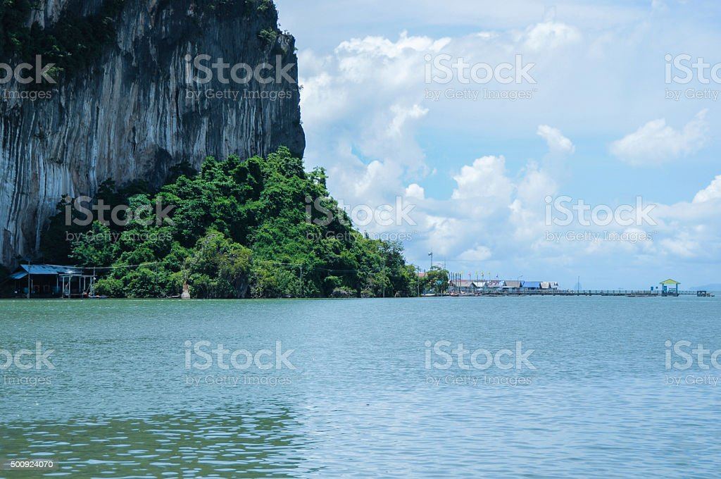 Cliffs and Trees near Floating Muslim Village. Koh Panyee Island stock photo