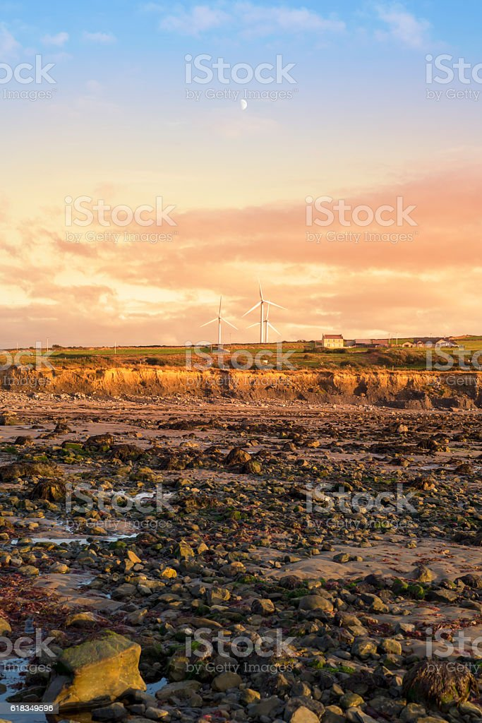 cliffs and wind farm at rocky beal beach stock photo