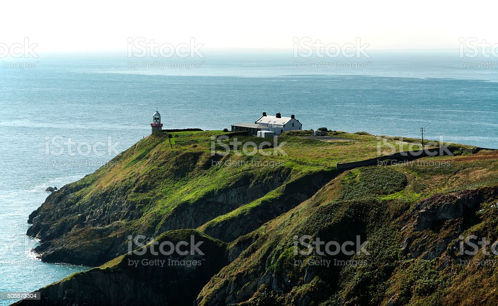 Cliffs in Howth and lighthouse, Ireland stock photo