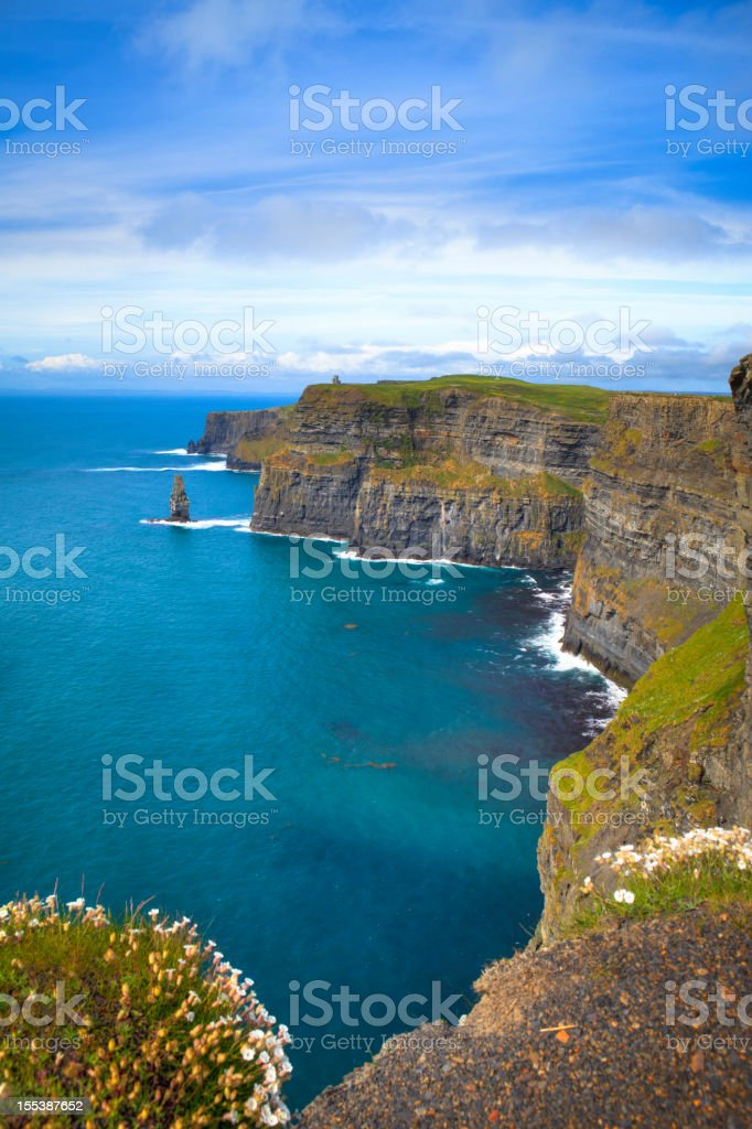 Cliffs near a mass of water in Moher, Ireland stock photo