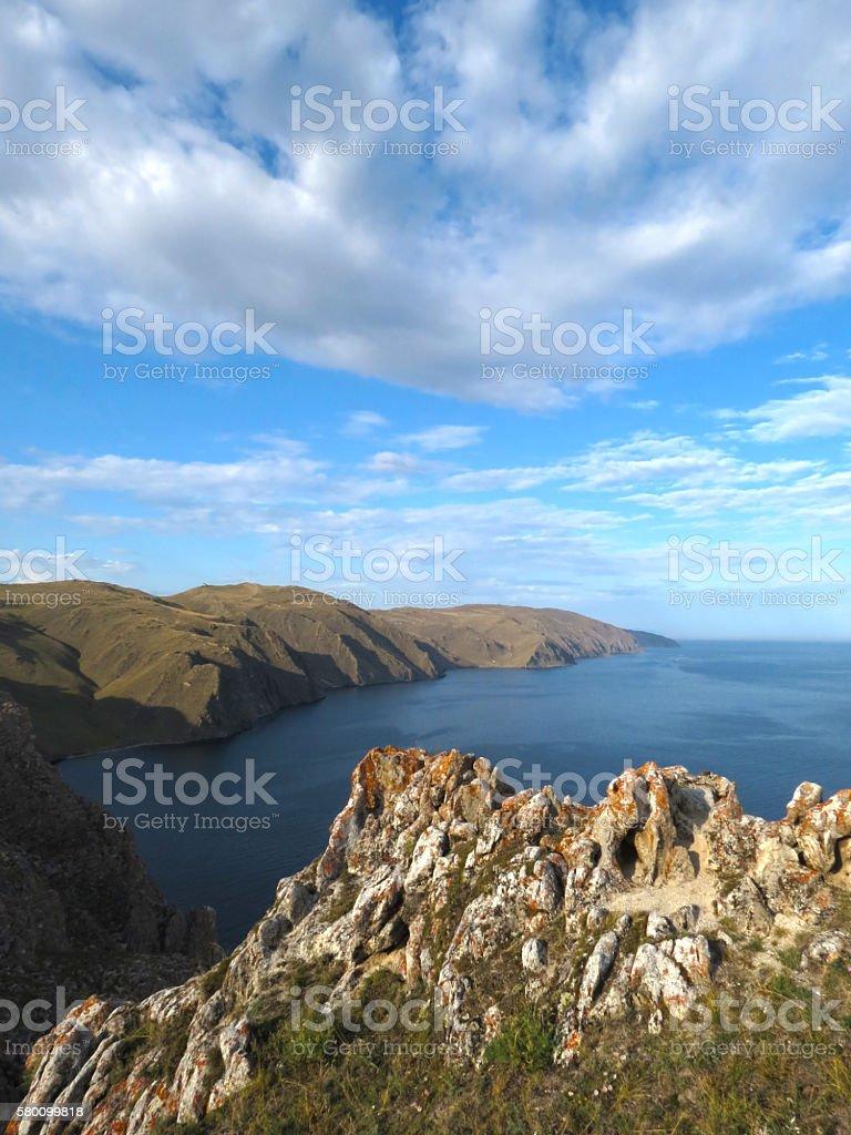 Cliffs near Aya bay at Lake Baikal. National park Pribaikalskiy. stock photo