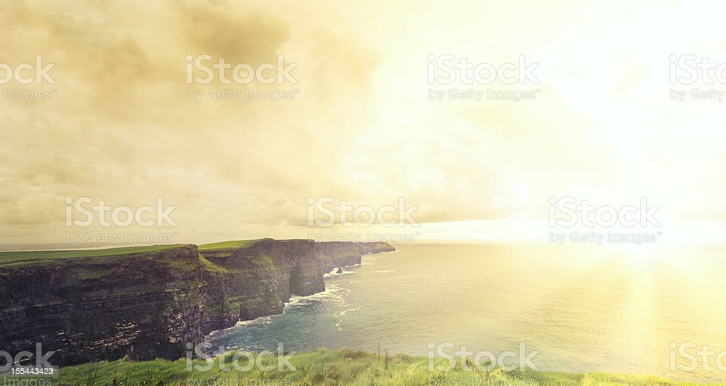 Cliffs Of Moher at Sunset . Panoramic royalty-free stock photo
