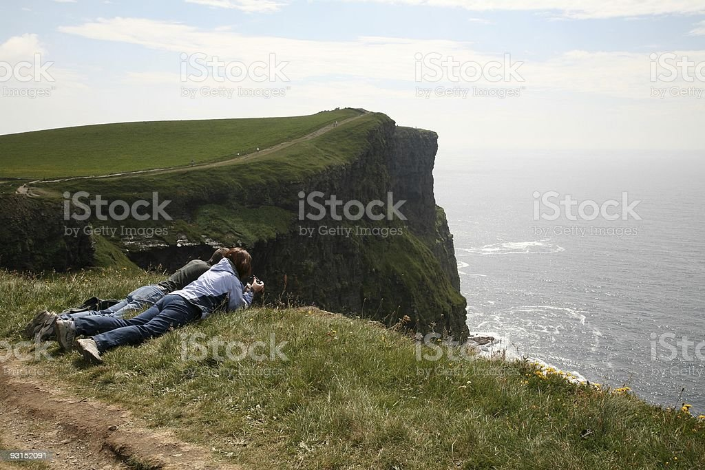 Cliffs of Moher Couple Adventure royalty-free stock photo