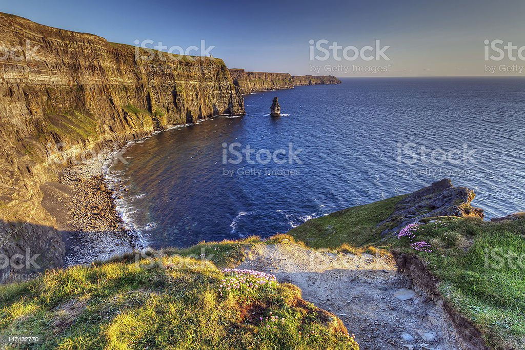 Cliffs of Moher in Ireland by the ocean stock photo