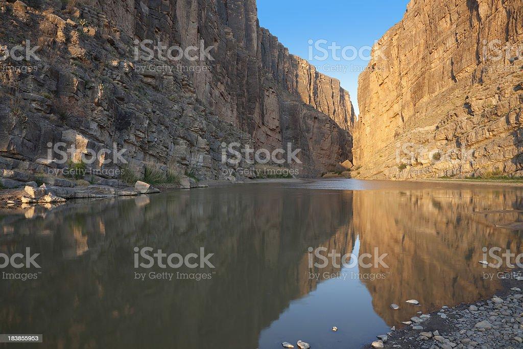 Cliffs of Santa Elena Canyon reflecting in Rio Grande River stock photo