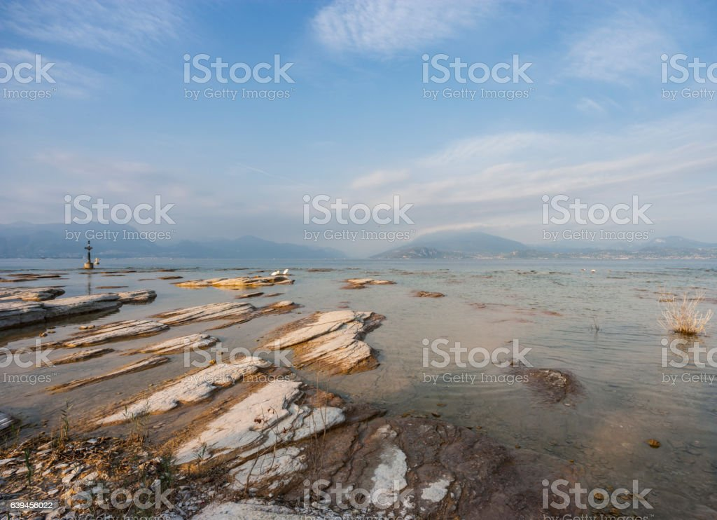 Cliffs  on the lakeside (Sirmione, Lake Garda, Italy) stock photo