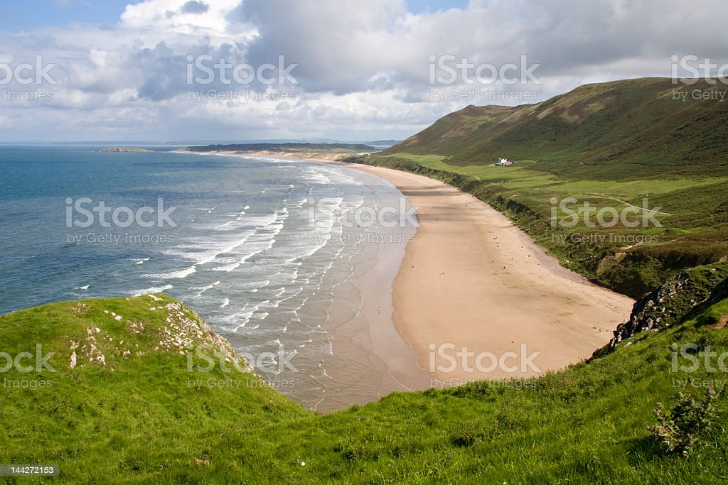 A clifftop view of Rhossili Beach royalty-free stock photo