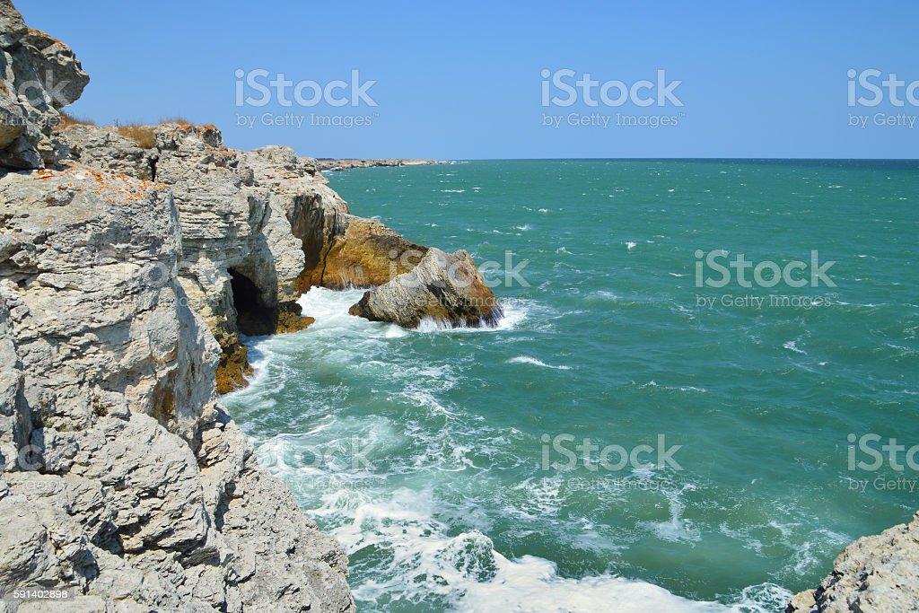 Clifs, rocks and green sea stock photo