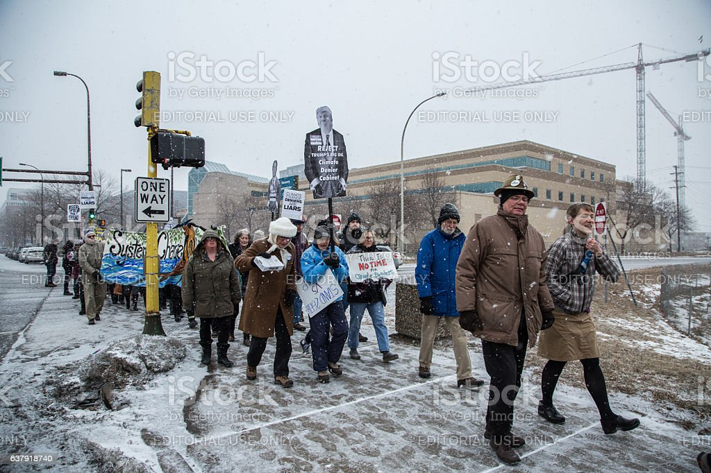Climate Activists March in the Snow in Minneapolis stock photo