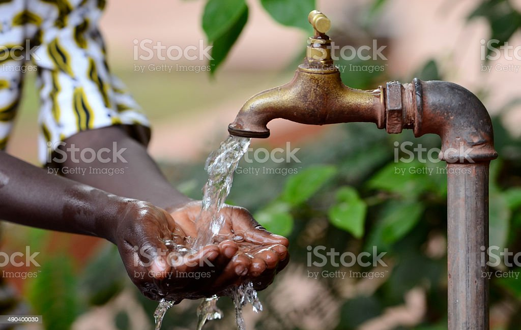 Climate Change Symbol: Handful Of Water Scarsity for Africa Symbol stock photo