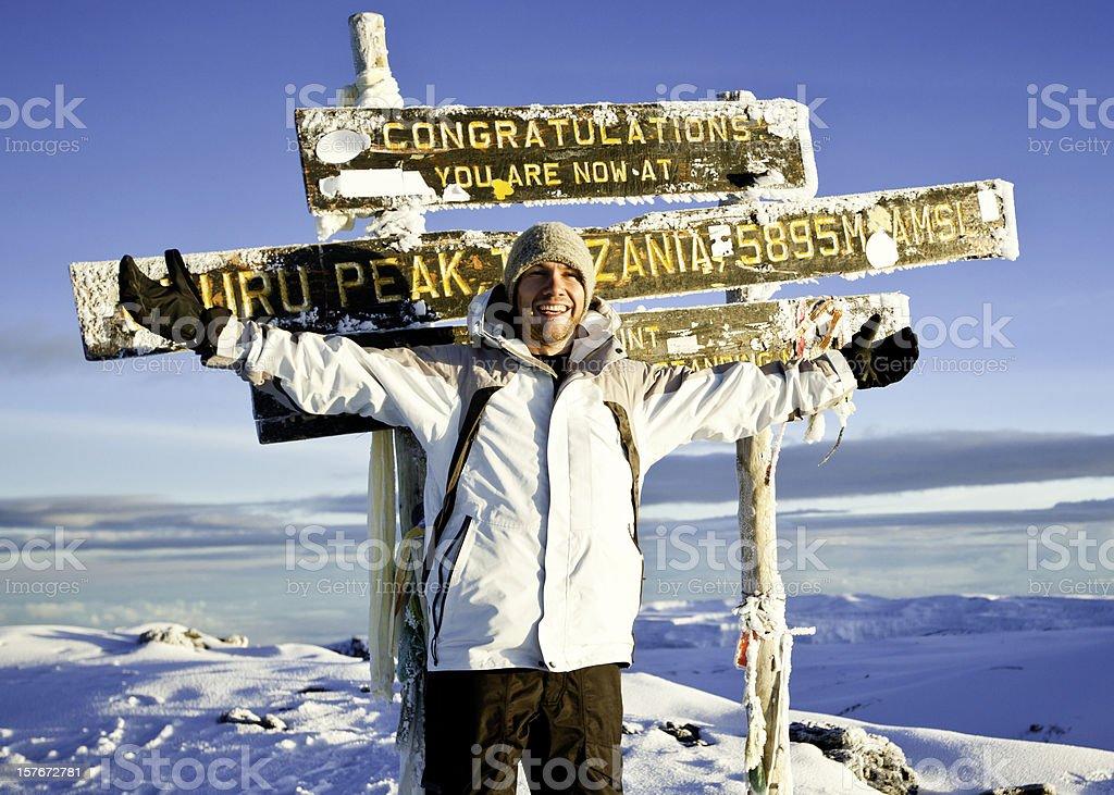 Climber at the Top of Mount Kilimanjaro stock photo